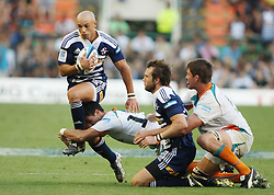 Conrad Jantjes tries to slip the tackle of Naas Olivier during the Super Rugby (Super 15) fixture between the DHL Stormers and the Cheetahs held at DHL Newlands Stadium in Cape Town, South Africa on 26 February 2011. Photo by Jacques Rossouw/SPORTZPICS
