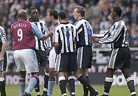 Photo. Glyn Thomas.<br /> Newcastle United v Aston Villa. Barclaycard Premiership.<br /> St James' Park, Newcastle. 01/11/03.<br /> Angry words are exchanged after Lee Bowyer receives a yellow card.