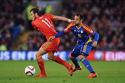 Gareth Bale of Wales jostles for the ball with Adria Rodrigues of Andorra - Mandatory byline: Dougie Allward/JMP - 07966 386802 - 13/10/2015 - FOOTBALL - Cardiff City Stadium - Cardiff, Wales - Wales v Andorra - European Qualifier 2016 - Group B
