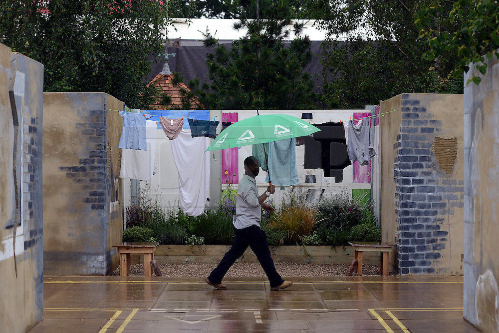 © Licensed to London News Pictures. 02/07/2012. East Molesey, UK A man in the Urban oasis garden. The RHS Hampton Court Palace Flower Show 2012. The show runs 3-8 July, 2012. Photo credit : Stephen Simpson/LNP