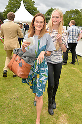 Left to right, the COUNTESS CAWDOR and her daughter LADY JEAN CAMPBELL at the Cartier Queen's Cup Final polo held at Guards Polo Club, Smith's Lawn, Windsor Great Park, Egham, Surrey on 15th June 2014.