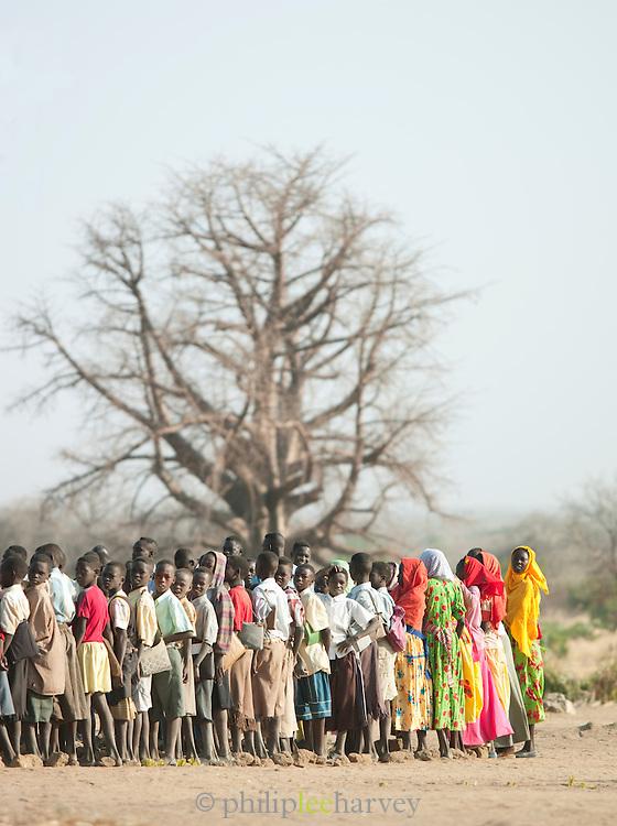 School children and teachers in the Nuba tribe in the village of Nyaro, Kordofan region, Sudan