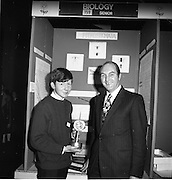 1972.07/01/1972.01/07/1972.7th January 1972.The Aer lingus Young Scientist Exhibition at the RDS, Dublin..George Colley T.D. Minister for Finance and Sean Mac Fheorais from Colaiste Mhuire, Cearnog Pharnell, Dublin with his winning exhibit 'Grinn-staidear ar pterostigmata'.