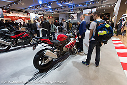 BMW display at EICMA, the largest international motorcycle exhibition in the world. Milan, Italy. November 17, 2015.  Photography ©2015 Michael Lichter.