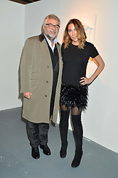 ROBERT BENSOUSSAN and ALEX MEYERS at the Women for Women International Catwalk Show & Auction in partnership with Brown's and sponsored by Swarovski held at The Vinyl Factory, Brewer Street Space, Brewer Street, London on 20th November 2014.