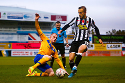 Neal Bishop of Mansfield Town slides in to tackle Charles Vernam of Chorley - Mandatory by-line: Ryan Crockett/JMP - 09/11/2019 - FOOTBALL - One Call Stadium - Mansfield, England - Mansfield Town v Chorley - Emirates FA Cup first round