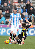 Adam Hammill of Huddersfield Townis tackled by Sam Hutchinson of Sheffield Wednesday during the Sky Bet Championship match at the John Smiths Stadium, Huddersfield<br /> Picture by Graham Crowther/Focus Images Ltd +44 7763 140036<br /> 22/02/2014