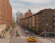 New York City -- April 12, 2017 -- A New York City street scene at 23rd Street and 10th Avenue on a Spring Day. Editorial and Illustrative. Editorial Use Only.