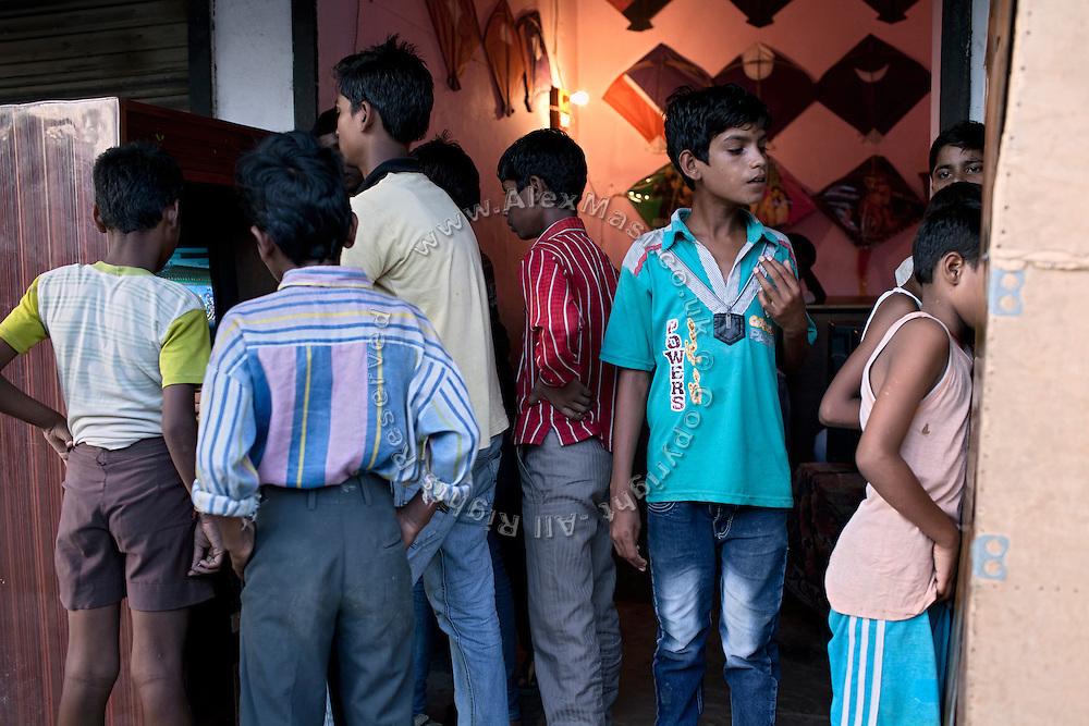 Boys are playing arcade video games on the roads of Madiyaw colony, Lucknow District, Uttar Pradesh.