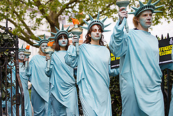 April 27, 2017 - London, London, UK - London, UK. One hundred Amnesty International activists dressed as 'Statues of Liberty' protest outside the US Embassy in London onÊThursday 27 AprilÊ2017 to mark US President Donald Trump's first 100 days in office. (Credit Image: © Tolga Akmen/London News Pictures via ZUMA Wire)