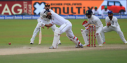 August 4, 2017 - Colombo, Sri Lanka - Sri Lankan cricketer Dinesh Chandimal plays a shot as indian cricket captain Virat Kohli(L) looks on during the 2nd Day's play in the 2nd Test match between Sri Lanka and India at the SSC international cricket stadium at the capital city of Colombo, Sri Lanka on Friday 04 August 2017. (Credit Image: © Tharaka Basnayaka/NurPhoto via ZUMA Press)
