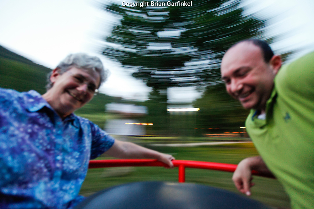 Mom and Brian on a merry go round in Trencin Teplice, Slovakia on Thursday, July 7th 2011.  (Photo by Brian Garfinkel)