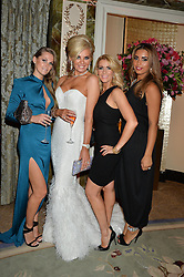 Left to right, JUDE CISSE wife of footballer Djibril Cisse, CLAIRE CAUDWELL, LEANNE BROWN wife of footballer Wes Brown and CHANTELLE TAGOE fiance of footballer Emile Heskey at a birthday dinner for Claire Caudwell for family & friends held at The Dorchester, Park Lane, London on 24th January 2014.