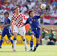 Photo: Chris Ratcliffe.<br /> Japan v Croatia. Group F, FIFA World Cup 2006. 18/06/2006.<br /> Ivan Klasnic of Croatia clashes with Shunsuke Nakamura of Japan.