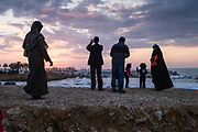Beirut, Lebanon, 21 Feb 2011, Family goes to the beach to see the sunset on a stormy day. PHOTO © Christophe Vander Eecken