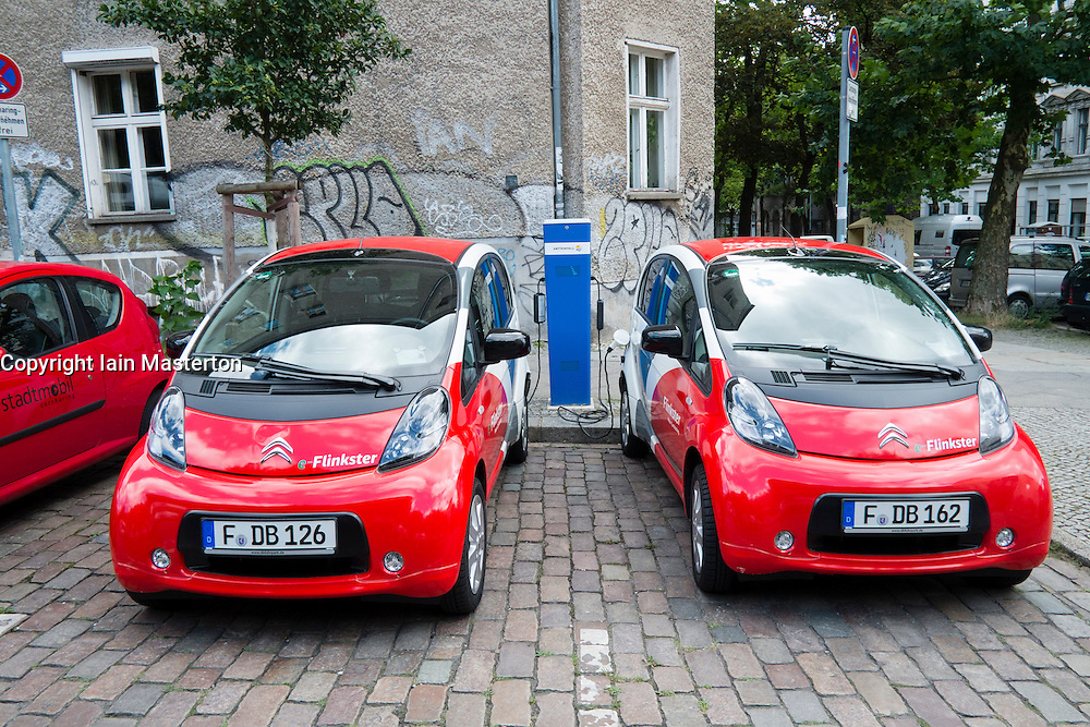 Two electric Flinkster car sharing cars charging on Berlin street Germany