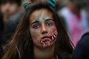 A portrait of a girl with zombie make-up on her face, on 8th October 2016 in Paris, France. Over 2000 Goules took part in the Zombie Walk through Paris, 8th October 2016. The walk went from Place de la Republique and finished at Place des Vosges  The event, an apocalyptic parade through Paris's historic downtown. Zombie walks as annual traditions are now relatively common in large cities, especially in North America.