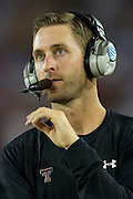 DALLAS, TX - AUGUST 30: Head coach Kliff Kingsbury of the Texas Tech Red Raiders looks on against the SMU Mustangs on August 30, 2013 at Gerald J. Ford Stadium in Dallas, Texas.  (Photo by Cooper Neill/Getty Images) *** Local Caption *** Kliff Kingsbury