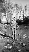 0705-J07 woman fishing. Montana. 1930s