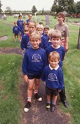 Group of junior school children going to church,
