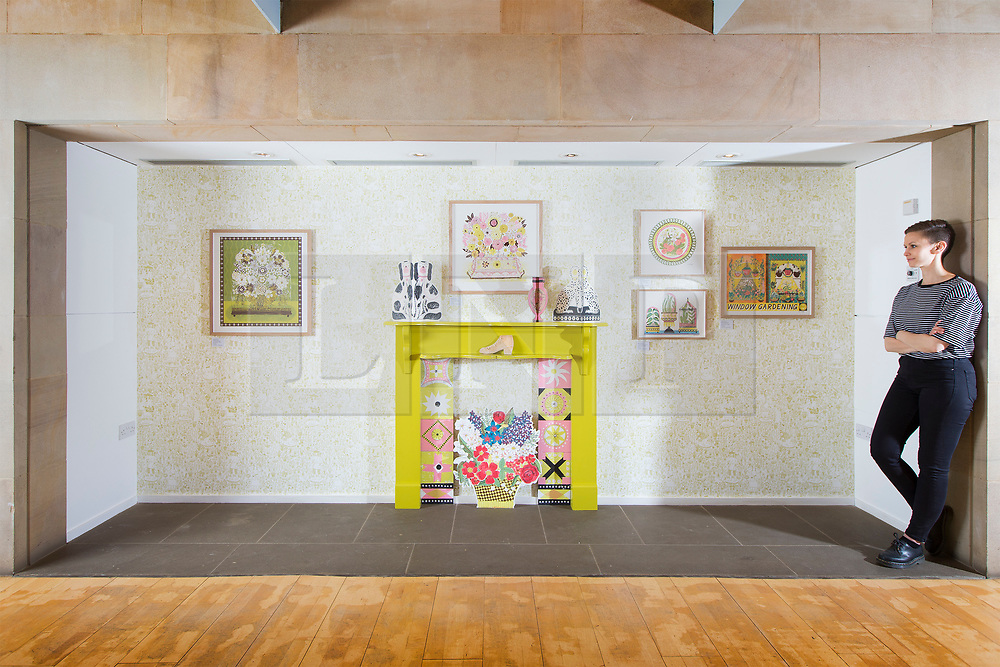© Licensed to London News Pictures. 15/06/2017. Wakefield UK. Picture shows Kerry Chase from the Yorkshire Sculpture park looking at a recreation Victorian Fireplace & mantelpiece by Illustrator Alice Pattullo. Alice Pattullo has a new exhibition at the Yorkshire Sculpture park called Of House & Home which is her most ambitious project to date & includes 60 new screen printed editions revealing Pattullo's fascination with traditions, superstitions & folklore. The exhibition takes visitors on a journey through a victorian household from garden to parlour culminating with the heart of the home a recreation of a traditional fireplace & mantlepiece. Photo credit: Andrew McCaren/LNP