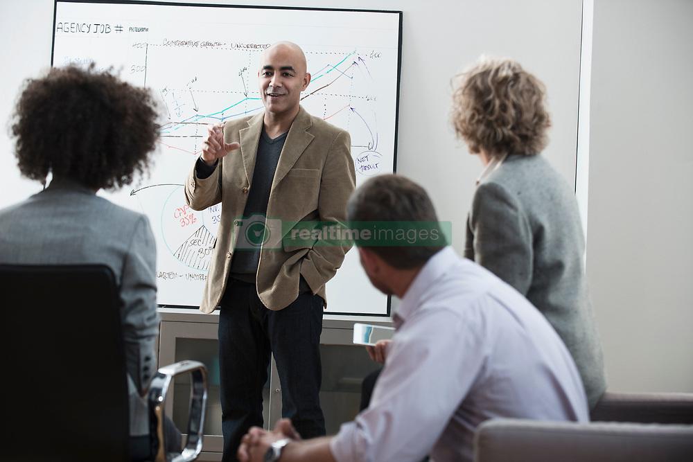 Businessman talking in meeting (Credit Image: © Image Source/Jose Pelaez/Image Source/ZUMAPRESS.com)