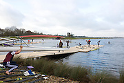Eton, GREAT BRITAIN,  Sculler picks up blades, whilst carrying boat, GB Trials 3rd Winter assessment at,  Eton Rowing Centre, venue for the 2012 Olympic Rowing Regatta, Trials cut short due to weather conditions forecast for the second day Saturday  12/02/2011   [Photo, Peter Spurrier/Intersport-images]