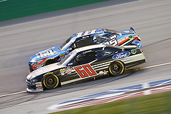 July 13, 2018 - Sparta, Kentucky, United States of America - Ty Majeski (60) and Kyle Busch (18) battle for position during the Alsco 300 at Kentucky Speedway in Sparta, Kentucky. (Credit Image: © Chris Owens Asp Inc/ASP via ZUMA Wire)