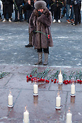 Moscow, Russia, 27/01/2011..A woman weeps while laying flowers at a memorial ceremony in central Moscow for the 35 people killed in the Domodedovo airport bombing.