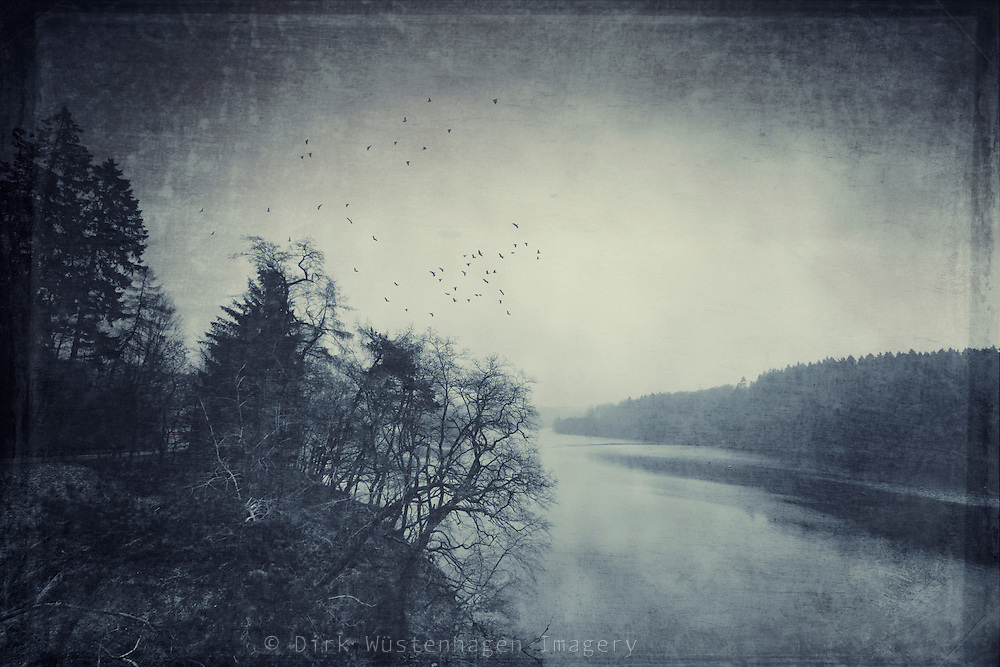 Dam in the surroundings of my hometown on a very cold winter's day. Textures photograph.<br /> <br /> Prints: http://society6.com/DirkWuestenhagenImagery/a-murder-of-crows-over-a-cold-lake_Print