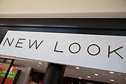 Sign for the high street clothing brand New Look in Birmingham, United Kingdom.
