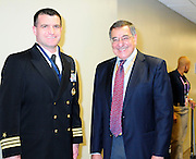 "FILE **2/3/13 New Orleans LA.-NFL FILE- US Secretary of Defense Leon Panetta poses with a member of the military at Super Bowl XLV11 at the Mercedes Benz Super Dome. Panetta had no comment on the  "" power outage"" during the third quarter of Super Bowl XLV11 in New Olreans. The Baltimore Ravens went on beat the San Francisco 49er's 34-31. Photo©Suzi Altman"