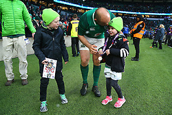 Ireland's Rory Best celebrates winning the grand slam with his family during the NatWest 6 Nations match at Twickenham Stadium, London.