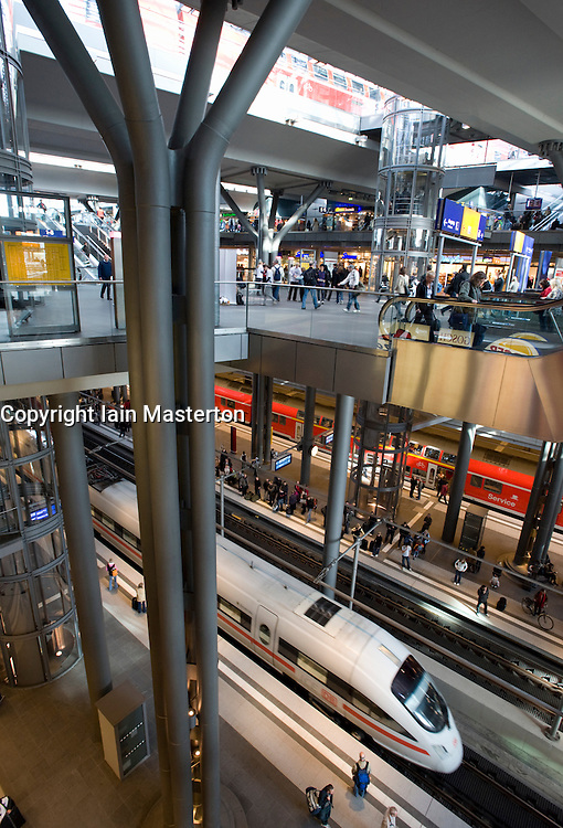Interior of large new modern main central railway station Hauptbahnhof in Berlin Germany 2008