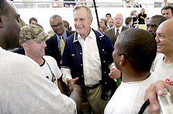 Former President George Bush talks with US athletes in training at the American College of Greece Friday August 13, 2004. Photo by Ron Cortes/Philadelphia Inquierer/KRT/ABACA.