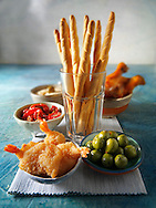 Party food - tappas with bread sticks and breaded butterfly prawns