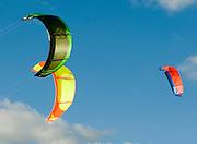 three Kites surfers kites in the sky