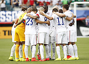 JACKSONVILLE, FL - JUNE 07:  The United States starting lineup huddles during the international friendly match against Nigeria at EverBank Field on June 7, 2014 in Jacksonville, Florida.  (Photo by Mike Zarrilli/Getty Images)