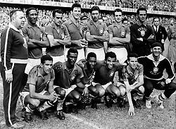 The victorious Brazil team with the trophy: (back row, l-r) Coach Vicente Feola, Djalma Santos, Zito, Bellini, Nilton Santos, Orlando, Gilmar  (front row, l-r) Garrincha, Didi, Pele, Vava, Mario Zagallo, trainer