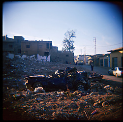 A flattened car sits in the afternoon sun amid devastation caused by the war between Israel and Hezbollah, Aytaroun, Southern Lebanon, Oct. 23, 2006.