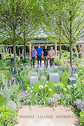 Young designers vying for RHS Chelsea Flower Show honours.<br /> Photographed on the 'Hope on the Horizon' garden, in aid of Help for Heroes.<br /> L-R David Rich (23, Vital Earth The Night Sky), Hugo Bugg (27, RBC Waterscape Garden), Matthew Keightley (29, Hope on the Horizon), Harry Rich (26, Vital Earth The Night Sky).  The<br /> 'Hope on the Horizon' garden in aid of Help for Heroes: produced by building and landscaping firm Farr and Roberts', making their debut; designed by Matthew Keightley (29), as a result of his brother Michael's involvement with the armed forces, having served on four tours to Afghanistan and due for his fifth this year; and sponsored by the David Brownlow charitable foundation. The garden layout is based on the shape of the Military Cross, the medal awarded for extreme bravery. Granite blocks will represent the soldiers' physical wellbeing and the planting represents their psychological wellbeing at various stages of their rehabilitation. Both evolve through the garden from a rough, unfinished, over-grown beginning through to a perfectly sawn, structured end. An avenue of hornbeams draws the attention through the entire garden to a sculpture resembling a hopeful horizon; a reminder to the soldiers that they all have a bright future ahead. As well as areas to recline and reflect, the garden offers focal points all the way through. Cool, calming colours are used throughout, helping to emphasise the fact that it will be a serene, contemplative space. After the Show, the garden will be moved and set within the grounds at Help for Heroes Recovery Centre at Chavasse VC House in Colchester, Essex. The garden will offer a serene, peaceful haven to contemplate and inspire a bright future and to support the challenging journey to recovery. The Chelsea Flower Show 2014. The Royal Hospital, Chelsea, London, UK