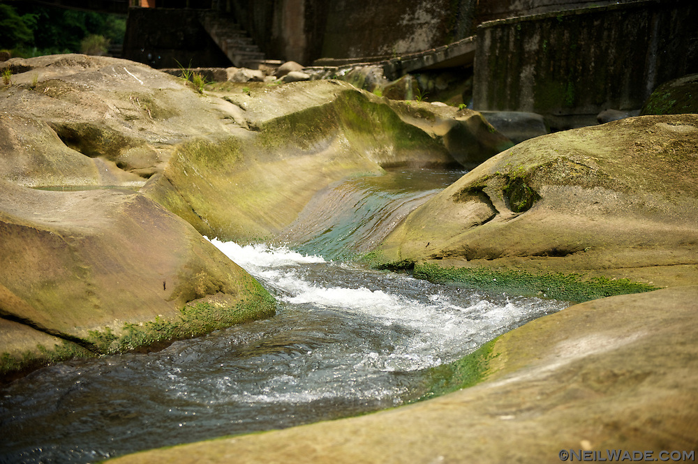 The stream cuts through the sandstone bedrock like butter in Shiding, Taiwan and leaves some interesting rock formations.