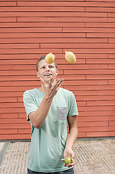 Young man juggling with lemons, Bavaria, Germany
