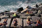 ITALY, Liguria, Zoagli.....ITALY, Liguria, Zoagli.relaxing on the rocks