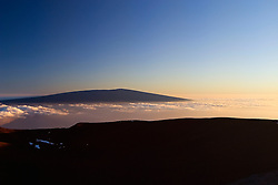 Silhouette of Mauna Loa summit at sunset, 13,680 feet or 4,170 meters above sea level, Big Island, Hawaii