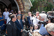 London Mayor, Sadiq Khan with Vicar Alan Everett outside St Clement's Church following Sunday morning service on the 18th June 2017 in North Kensington, London, United Kingdom.The Grenfell Tower fire occurred on 14th June 2017 at the 24-storey block of public housing flats in North Kensington, West London. It caused at least 80 deaths and over 70 injuries, yet the actual numbers have yet to be confirmed