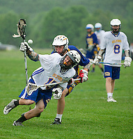 Gilford Lacrosse versus Kearsarge for first round tournament play at the Meadows Field Tuesday evening.  (Karen Bobotas/for the Laconia Daily Sun)