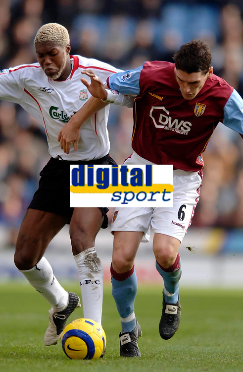 Photo: Glyn Thomas.<br />Aston Villa v Liverpool. The Barclays Premiership. <br />05/11/2005.<br />Liverpool's Djibril Cisse (L) battles for the ball with Gareth Barry.
