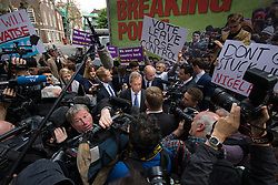 """Smith Square, Westminster, London, June 16th 2016. UKIP leader Nigel Farage launches his """"biggest ever"""" advertising campaign as Leave and Remain enter their last week of campaigning before the EU referendum on June 23rd. PICTURED: Remain counter-campaigners disrupt UKIP's launch as Farage speaks to the media."""