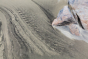 Patterns caused by sediment transport by water in the sand on Bunes Beach, Moskenesoya, Lofoten Islands, Norway.